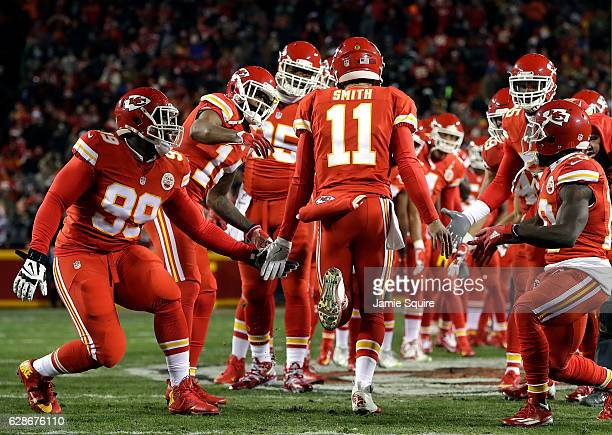 Quarterback Alex Smith of the Kansas City Chiefs highfives teammates during player introductions ahead of the game against the Oakland Raiders at...