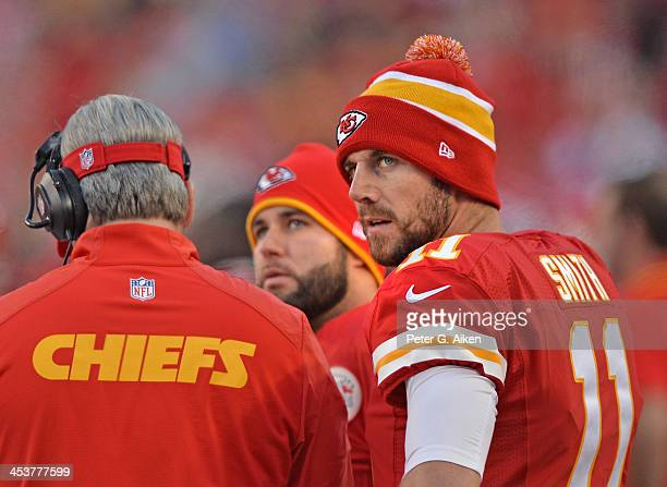 Quarterback Alex Smith of the Kansas City Chiefs looks on from the sidelines against the Denver Broncos during the first half on December 1 2013 at...