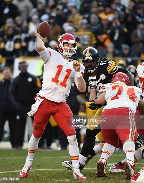 Quarterback Alex Smith of the Kansas City Chiefs passes as offensive lineman Jeff Linkenbach blocks defensive lineman Steve McLendon of the...