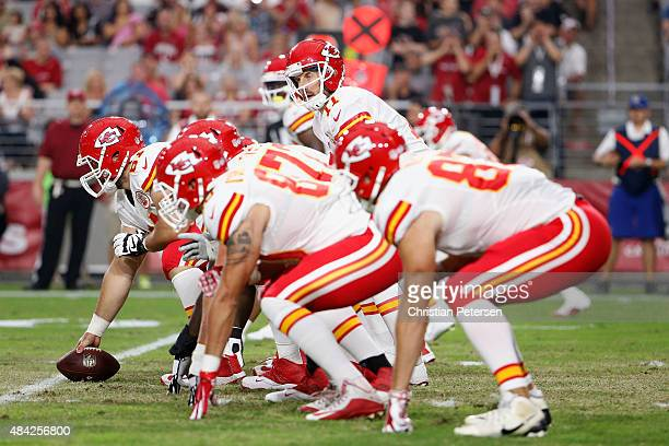 Quarterback Alex Smith of the Kansas City Chiefs prepares to snap the football during the preseason NFL game against the Arizona Cardinals at the...