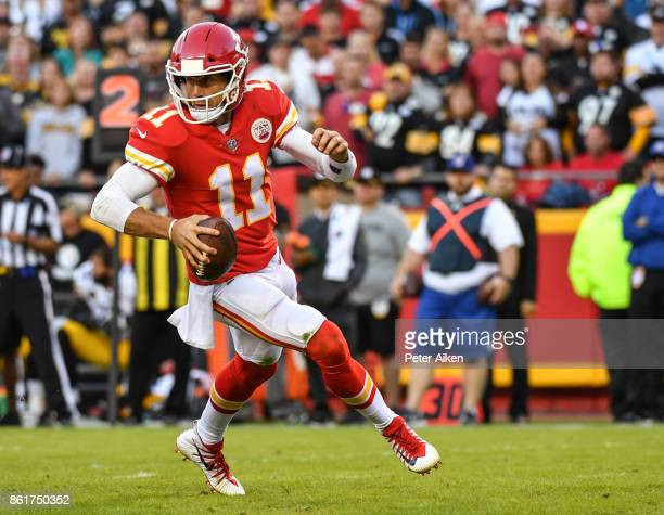 Quarterback Alex Smith of the Kansas City Chiefs rolls out of the pocket during the second half of the game against the Pittsburgh Steelers at...