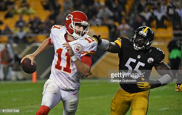 Quarterback Alex Smith of the Kansas City Chiefs runs from linebacker Arthur Moats of the Pittsburgh Steelers during a game at Heinz Field on October...