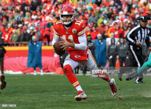 Quarterback Alex Smith of the Kansas City Chiefs runs out of the pocket in the fourth quarter of the game against the Miami Dolphins at Arrowhead...
