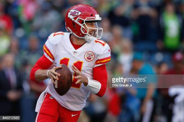 Quarterback Alex Smith of the Kansas City Chiefs rushes against the Seattle Seahawks at CenturyLink Field on August 25 2017 in Seattle Washington