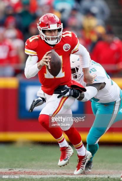 Quarterback Alex Smith of the Kansas City Chiefs scrambles as defensive end Charles Harris of the Miami Dolphins defends during the game at Arrowhead...