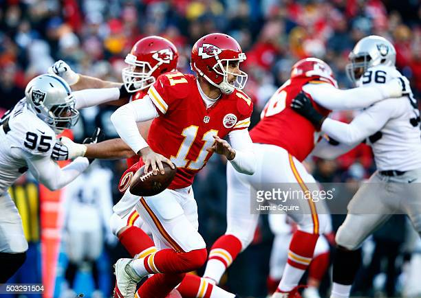 Quarterback Alex Smith of the Kansas City Chiefs scrambles during the game against the Oakland Raiders at Arrowhead Stadium on January 3 2016 in...