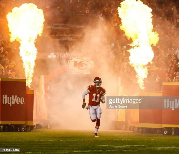 Quarterback Alex Smith of the Kansas City Chiefs takes the field in a fiery introduction prior to the game against the Denver Broncos at Arrowhead...