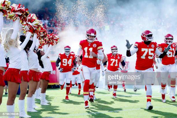 Quarterback Alex Smith of the Kansas City Chiefs takes the field with teammates prior to the game against the Buffalo Bills at Arrowhead Stadium on...