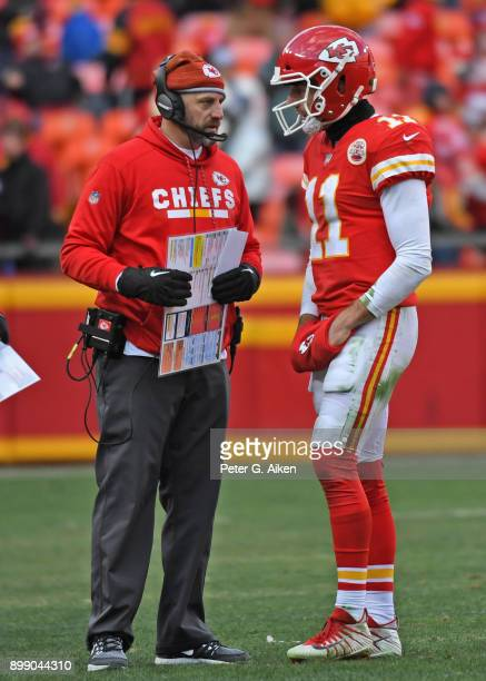 Quarterback Alex Smith of the Kansas City Chiefs talks with cooffensive coordinator Matt Nagy against the Miami Dolphins during the second half of...
