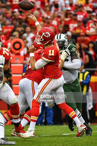 Quarterback Alex Smith of the Kansas City Chiefs throws a pass against the New York Jets at Arrowhead Stadium during the fourth quarter of the game...