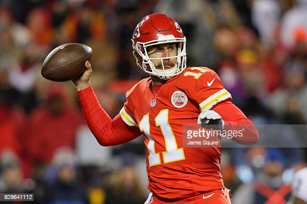Quarterback Alex Smith of the Kansas City Chiefs throws a pass against the Oakland Raiders at Arrowhead Stadium during the first quarter of the game...