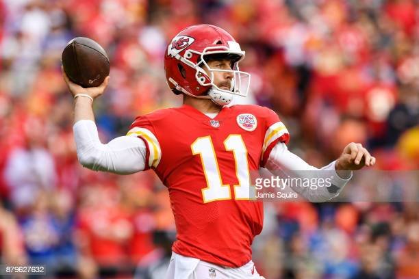 Quarterback Alex Smith of the Kansas City Chiefs throws a pass against the Buffalo Bills during the first quarter of the game at Arrowhead Stadium on...