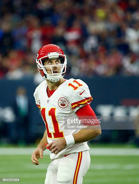 Quarterback Alex Smith of the Kansas City Chiefs walks to the bench in the second quarter against the Houston Texans during the AFC Wild Card Playoff...