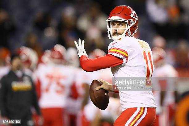 Quarterback Alex Smith of the Kansas City Chiefs warms up before the game against the Denver Broncos at Sports Authority Field at Mile High on...