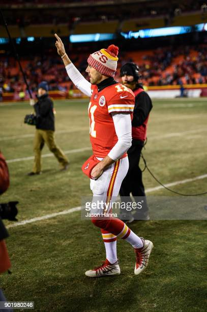 Quarterback Alex Smith of the Kansas City Chiefs waves to the crowd as he walks off the field following the loss to the Tennessee Titans in the AFC...