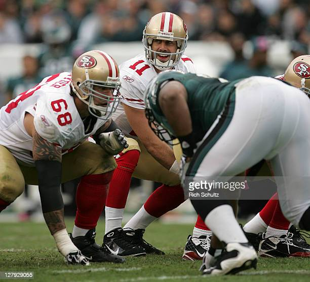 Quarterback Alex Smith of the San Francisco 49ers calls the signals as lineman Adam Snyder gets set to block against the Philadelphia Eagles during...