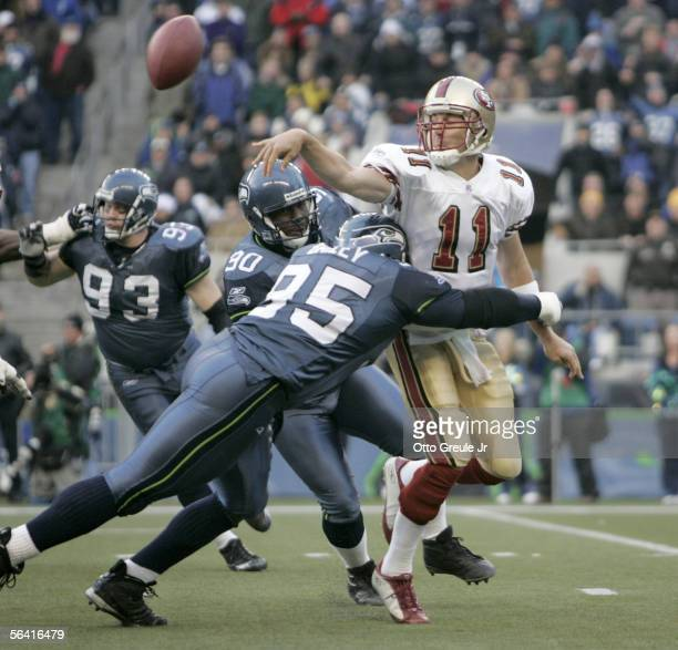 Quarterback Alex Smith of the San Francisco 49ers is tackled by defensive end Rodney Bailey of the Seattle Seahawks in the second half of the 49ers'...
