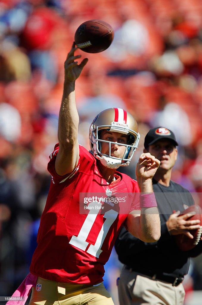 Quarterback Alex Smith #11 of the San Francisco 49ers passes during warmups as head coach Jim Harbaugh watches before a game against the Buffalo Billson October 7, 2012 at Candlestick Park in San Francisco, California. The 49ers won 45-3.
