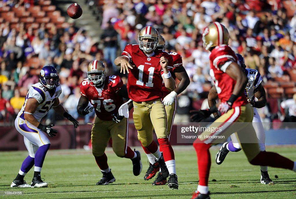 Quarterback Alex Smith #11 of the San Francisco 49ers scrambles away from the rush of the Minnesota Vikings to get his pass off during the preseason game on August 22, 2010 at Candlestick Park in San Francisco, California. The 49ers won the game 15-10.