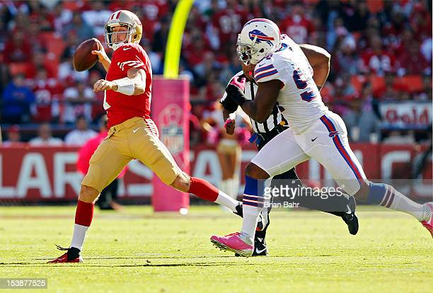 Quarterback Alex Smith of the San Francisco 49ers throws against defensive end Mario Williams of the Buffalo Bills in the fourth quarter on October 7...