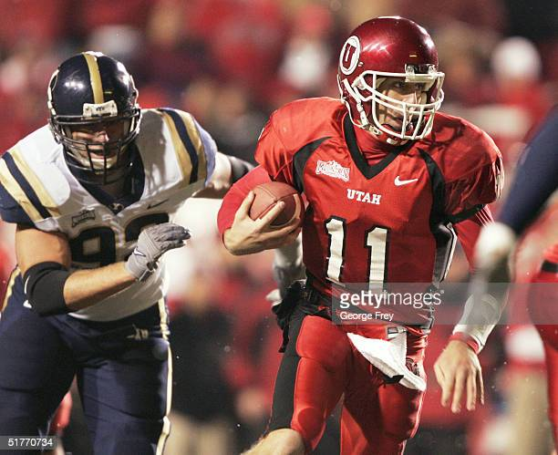 Quarterback Alex Smith of the University of Utah scrambles for a first down as John Denney of BYU gives chase during the second quarter November 20...