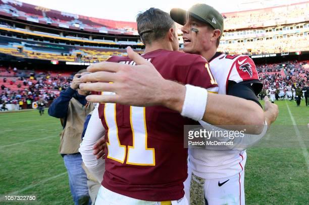 Quarterback Alex Smith of the Washington Redskins and quarterback Matt Ryan of the Atlanta Falcons talk after the Falcons defeated the Redskins 3814...