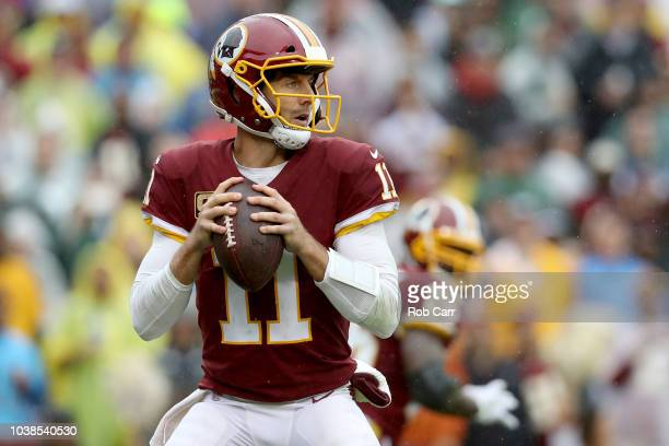 Quarterback Alex Smith of the Washington Redskins drops back to pass against the Green Bay Packers in the first half at FedExField on September 23...
