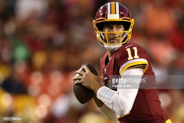 Quarterback Alex Smith of the Washington Redskins looks to pass against the Denver Broncos in the first half during a preseason game at FedExField on...