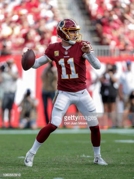Quarterback Alex Smith of the Washington Redskins on a pass play during a game against the Tampa Bay Buccaneers at Raymond James Stadium on November...
