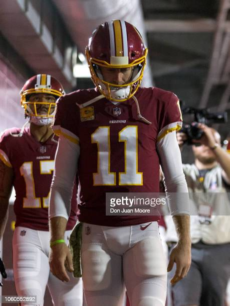 Quarterback Alex Smith of the Washington Redskins walks through the tunnel before the start of the game against the Tampa Bay Buccaneers at Raymond...