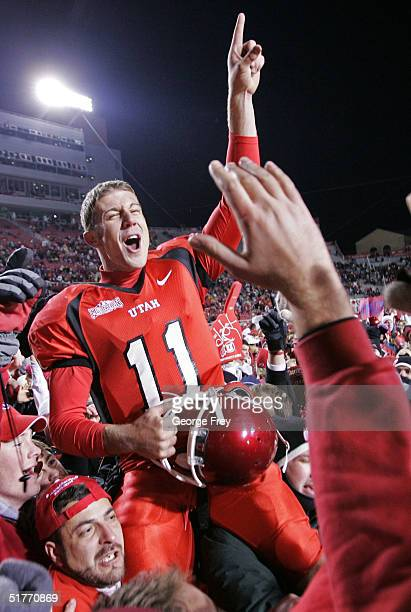 Quarterback Alex Smith of University of Utah is carried off the field by fans after Utah beat BYU 5221 November 20 2004 at Rice Eccles Stadium in...