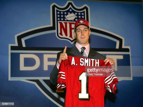 Quarterback Alex Smith poses with his jersey during the 70th NFL Draft on April 23 2005 at the Jacob K Javits Convention Center in New York City...