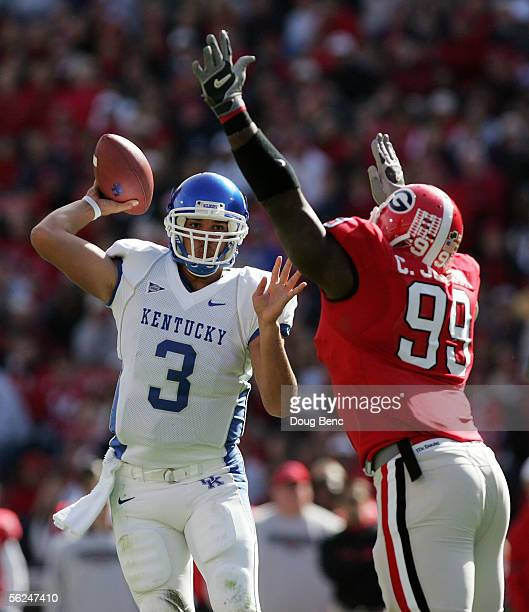 Quarterback Andre Woodson of the Kentucky Wildcats throws a pass over the defense of defensive end Charles Johnson of the Georgia Bulldogs at Sanford...