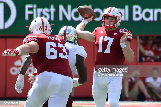Quarterback Andrew Bunch of the Nebraska Cornhuskers passes in the second half against the Troy Trojans at Memorial Stadium on September 15 2018 in...