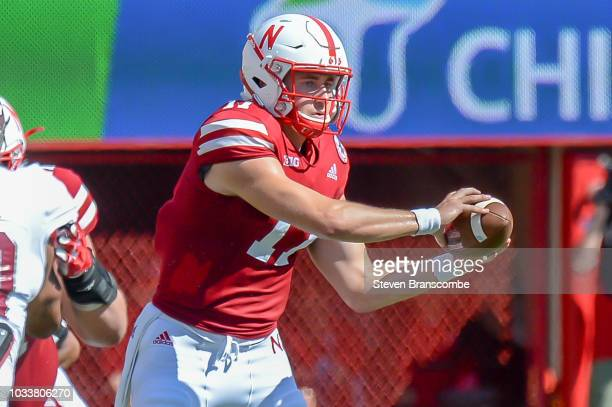 Quarterback Andrew Bunch of the Nebraska Cornhuskers reaches for a snap in the first half against the Troy Trojans at Memorial Stadium on September...
