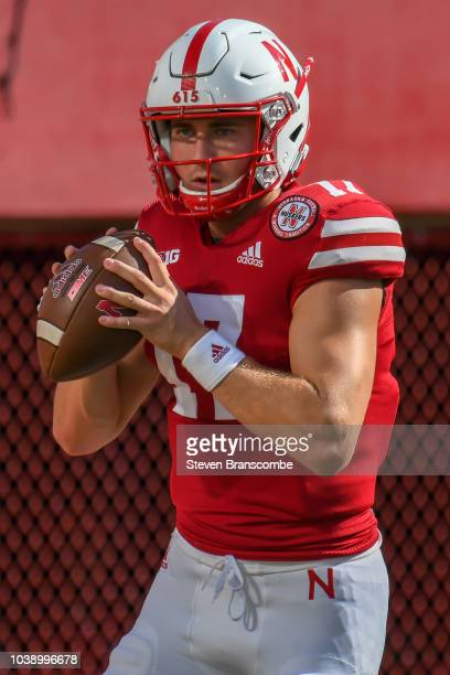 Quarterback Andrew Bunch of the Nebraska Cornhuskers warms up before the game against the Troy Trojans at Memorial Stadium on September 15 2018 in...