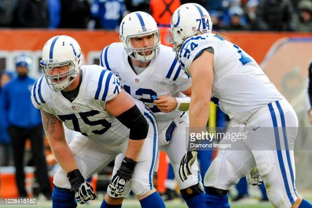 Quarterback Andrew Luck of the Indianapolis Colts instructs offensive guard Jack Mewhort and offensive tackle Anthony Castonzo in the third quarter...