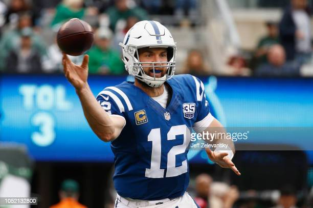 Quarterback Andrew Luck of the Indianapolis Colts throws a pass against the New York Jets during the second quarter at MetLife Stadium on October 14...