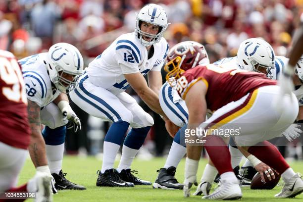 Quarterback Andrew Luck of the Indianapolis Colts under center in the first half against the Washington Redskins at FedExField on September 16 2018...