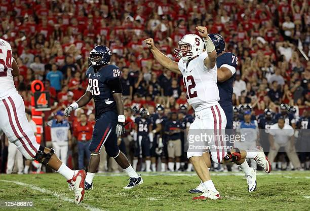 Quarterback Andrew Luck of the Stanford Cardinal celebrates after Anthony Wilkerson scored a 24 yard rushing touchdown against the Arizona Wildcats...