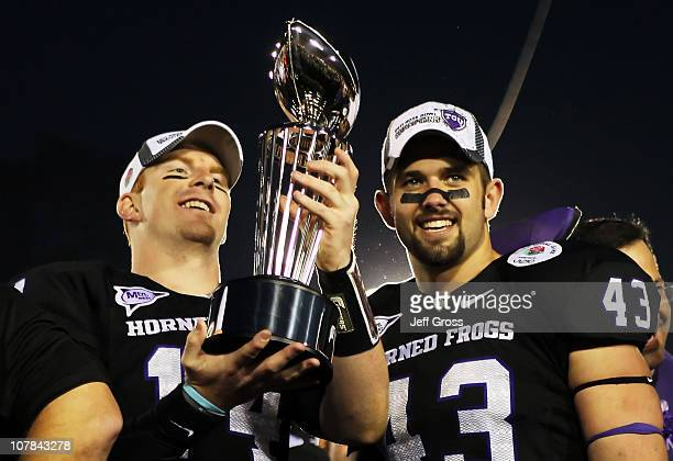 Quarterback Andy Dalton and linebacker Tank Carder of the TCU Horned Frogs hold the Rose Bowl Championship Trophy after defeating the Wisconsin...