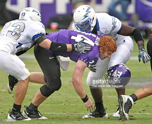 TCU quarterback Andy Dalton loses his helmet after being hit by Air Force defenders Aaron Kirchoff and Andre Morris in the second quarter at Amon G...