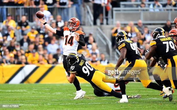 Quarterback Andy Dalton of the Cincinnati Bengals attempts a pass while under pressure from TJ Watt of the Pittsburgh Steelers in the first quarter...