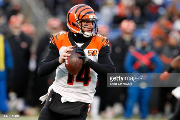 Quarterback Andy Dalton of the Cincinnati Bengals drops back in the first quarter against the Baltimore Ravens at MT Bank Stadium on December 31 2017...