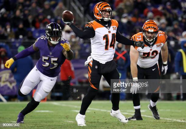 Quarterback Andy Dalton of the Cincinnati Bengals gets off a pass in front of outside linebacker Terrell Suggs of the Baltimore Ravens at MT Bank...
