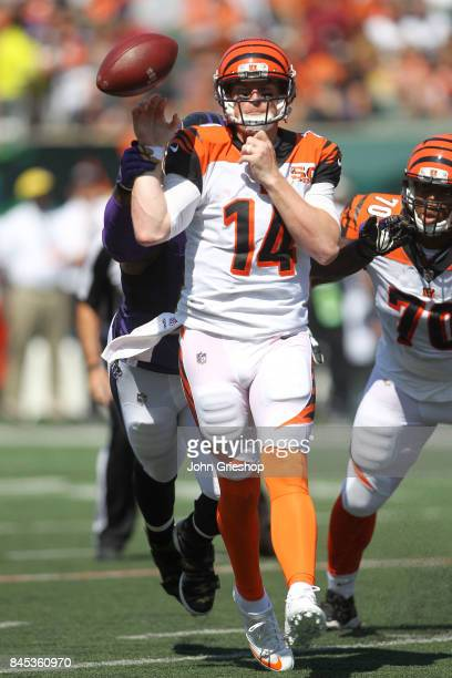 Quarterback Andy Dalton of the Cincinnati Bengals has the ball knocked out of his hand by Terrell Suggs of the Baltimore Ravens in the third quarter...