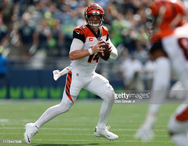 Quarterback Andy Dalton of the Cincinnati Bengals looks downfield to pass against the Seattle Seahawks at CenturyLink Field on September 8 2019 in...