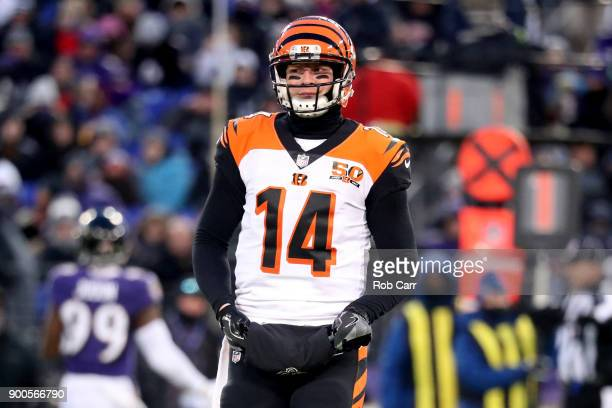 Quarterback Andy Dalton of the Cincinnati Bengals looks on against the Baltimore Ravens at MT Bank Stadium on December 31 2017 in Baltimore Maryland