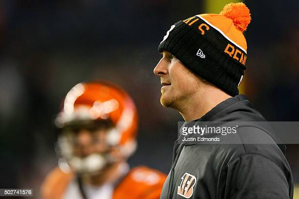 Quarterback Andy Dalton of the Cincinnati Bengals looks on as players warm up before a game against the Denver Broncos at Sports Authority Field at...