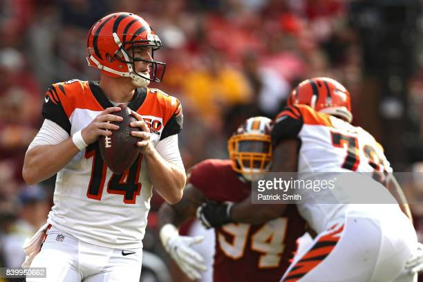 Quarterback Andy Dalton of the Cincinnati Bengals looks to pass against the Washington Redskins in the first half during a preseason game at...